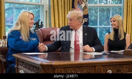 Houston, USA. 24th Apr, 2017. U.S President Donald Trump, shakes hands with NASA astronaut Kate Rubins, left, as - Stock Photo