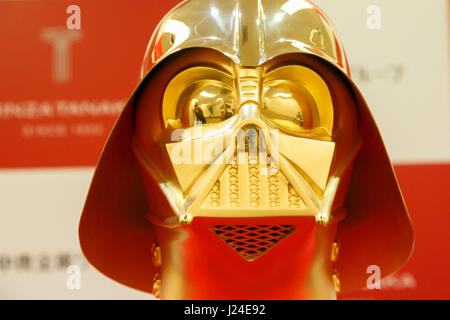 Tokyo, Japan. 25th Apr, 2017. A pure gold Darth Vader mask on display at the Ginza Tanaka jewelry store on April - Stock Photo