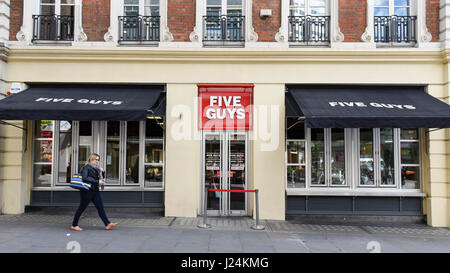 London, UK. 25th Apr, 2017. The Five Guys restaurant is seen in Covent Garden. Five Guys the burger chain, is in - Stock Photo