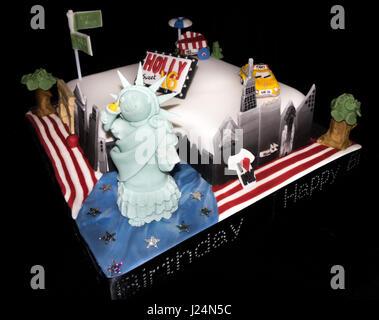 Homemade New York, USA, themed sixteenth birthday cake with Statue of Liberty, yellow cab, skyline, ice cream van - Stock Photo