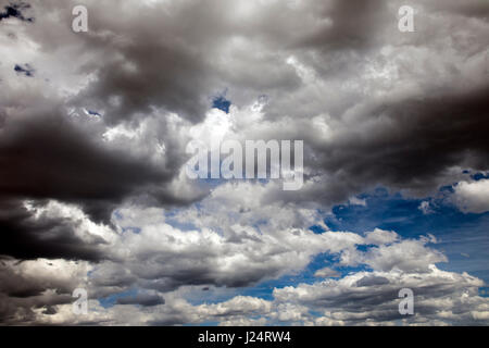 Clouds & sun against a Colorado blue background - Stock Photo
