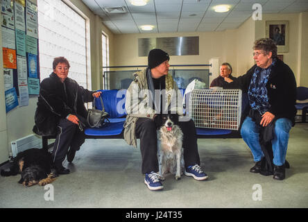 Pet owners in the waiting room at the Blue Cross Animal Hospital, Victoria, London, United Kingdom - Stock Photo