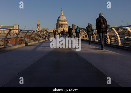 Commuters walking on the Millennium footbridge towards St Paul's Cathedral, London - Stock Photo