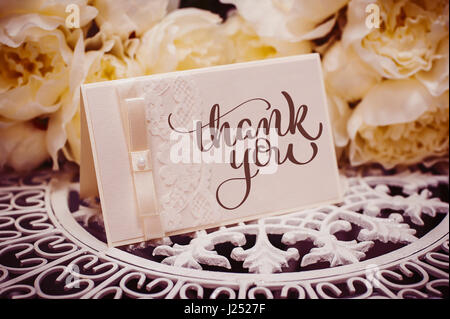 empty card to place text surrounded by flowers with text Thank you. Calligraphy lettering hand draw - Stock Photo