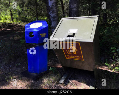 Bear Proof Container Next to Recycling Container. - Stock Photo
