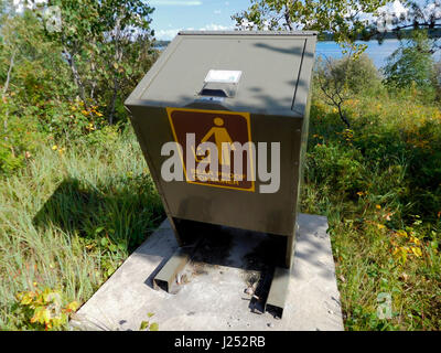 Bear Proof Garbage Container By Lake. - Stock Photo