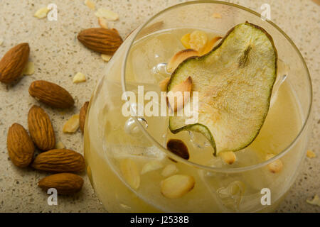 Tequila shaken with pear juice, agave, fresh lime and almond. Served in a martini glass and garnished with toasted - Stock Photo