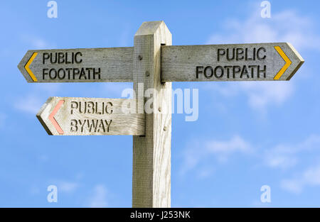 Public Footpath and Public Byway sign against blue sky. - Stock Photo