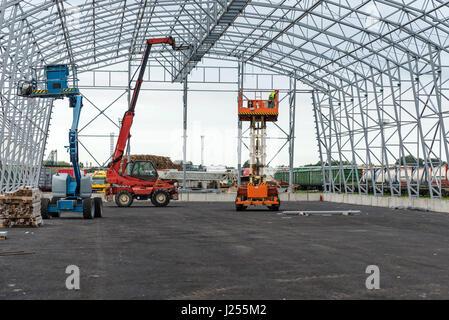 Lift with platform work in warehouse hangar construction field. - Stock Photo