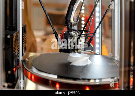 RIGA, LATVIA - MARCH 29, 2017: 3D printer during work process. New printing technology. - Stock Photo