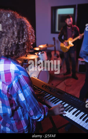Musicians playing piano and guitar in the recording studio - Stock Photo