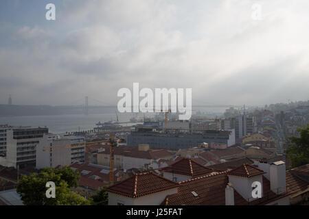 View of 25 de Abril Bridge in Lisbon, Portugal. - Stock Photo