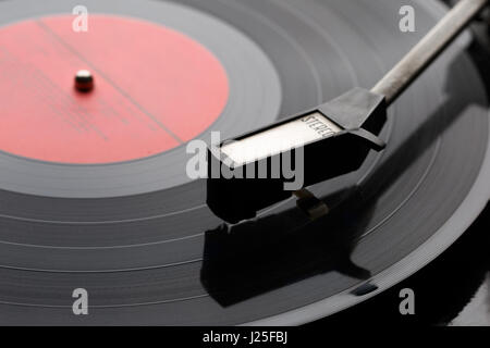 Black vinyl plate with player - Stock Photo