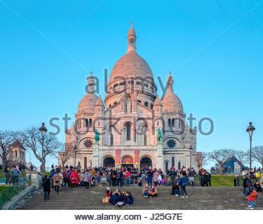 France, Île-de-France, Paris. Basilica of Sacre Coeur at sunset, Montmartre. - Stock Photo