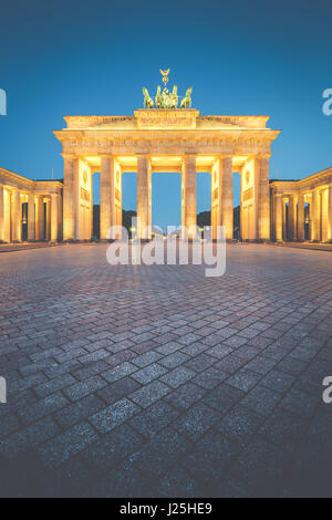 Classic vertical view of Brandenburg Gate, Germany's most famous landmark and a national symbol, in post sunset - Stock Photo