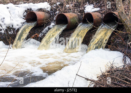 Water flows from large pipes - Stock Photo