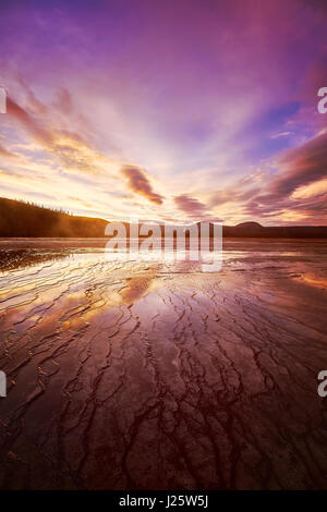 Picturesque pink sunset at Grand Prismatic Spring in Yellowstone National Park, Wyoming, USA. - Stock Photo