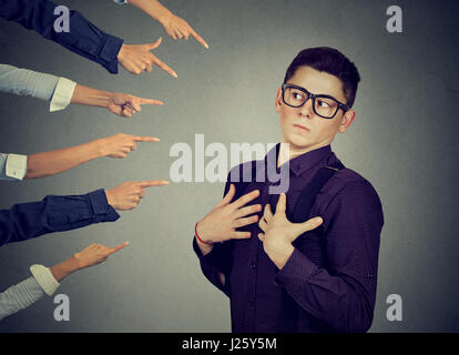 Blaming you. Anxious man in denial judged by different people who point fingers at him. Concept of accusation of - Stock Photo