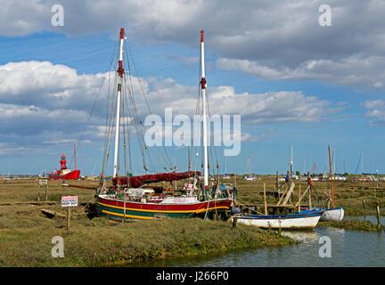 Boats on saltmarsh, Tollesbury, Essex, England UK - Stock Photo