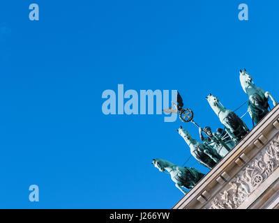 Detail of Quadriga on Brandenburg Gate in Berlin, Germany - Stock Photo