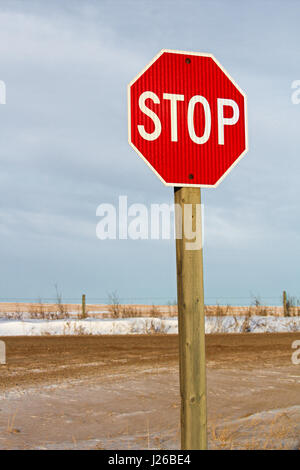 Country Road Stop Sign in Winter. - Stock Photo