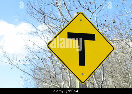 T crossing road sign - Stock Photo