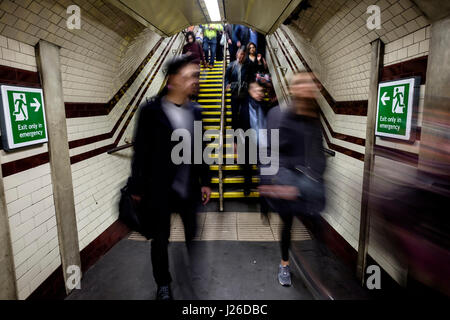 People walking fast during rush hour at an underground metro station in London, England, UK, Europe - Stock Photo