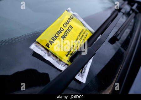 Parking charge notice on a car windscreen - Stock Photo