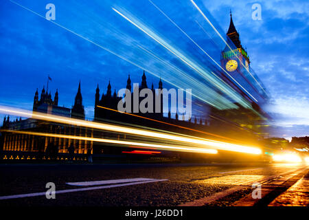 Light trails from car headlights passing next to the Houses of Parliament and the Big Ben in London, England, UK, - Stock Photo