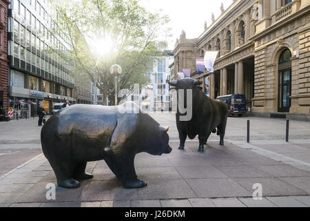 Statues of a bear and bull in front of the Stock Exchange building in Frankfurt, Germany, Europe - Stock Photo