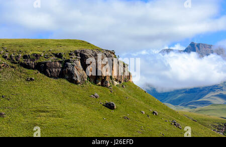 Drakensberg,Giants Castle,South Africa,mountains,green valley,dense clouds and a blue sky on a sunny day panorama - Stock Photo