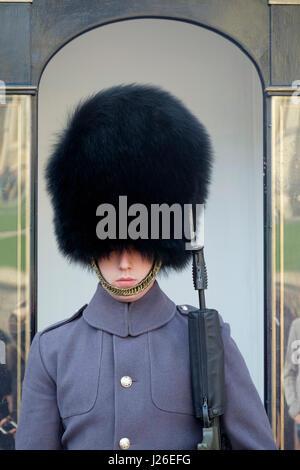 Queen's guard in Winter uniform at Windsor Castle, England, UK, Europe - Stock Photo