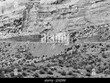 Part of the Rim Rock Drive, the road going through the Colorado National Monument, in front of a cliff. The picture - Stock Photo