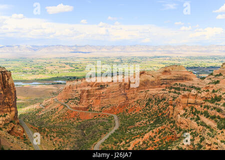 Part of the Colorado National Monument with the Rim Rock Drive and the Book Cliffs in the back. - Stock Photo