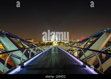 Illuminated Millennium Bridge and St. Paul's Cathedral, night shot, London, England, United Kingdom - Stock Photo