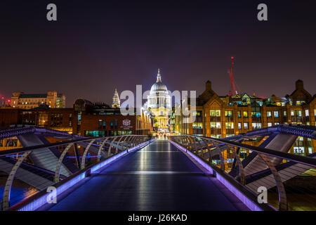 Illuminated Millennium Bridge and St. Paul's Cathedral, night shot, London, England, United Kingdom - Stock Photo
