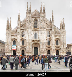 Milan, Italy - October 15, 2016: Crowded square near Milan Cathedral (Duomo di Milano) - Stock Photo