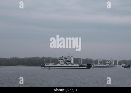 Car ferries across Swina river to Swinoujscie in Poland - Stock Photo
