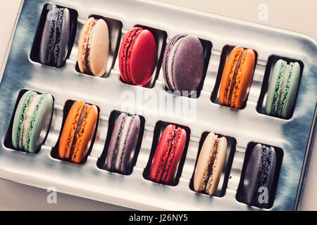 Colorful macaroons in box. Toned photo, Toned photo, vintage filter. - Stock Photo