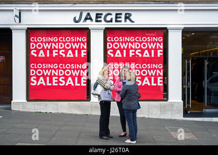Closing Down Sale signs on a branch of Jaeger ion the corner of  George Street and Dundas Street, Edinburgh, Scotland, - Stock Photo