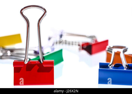 Collection of colourful foldback clips isolated on a white background - Stock Photo