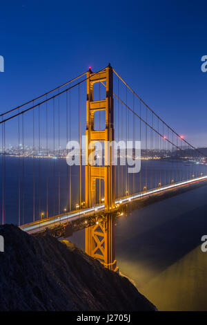Classic vertical view of famous Golden Gate Bridge seen from Battery Spencer viewpoint in beautiful post sunset - Stock Photo