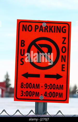 No Parking in Bus School Zone Sign With Applicable Hours - Stock Photo