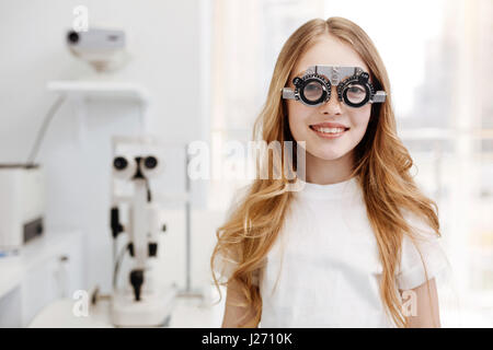 Beautiful teenage girl wearing trial glasses - Stock Photo