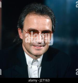 Italienischer Musikproduzent und Komponist Giorgio Moroder, Deutschland 1980er Jahre. Italian music producer and - Stock Photo