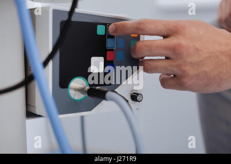 Part of medical instrument starting work - Stock Photo