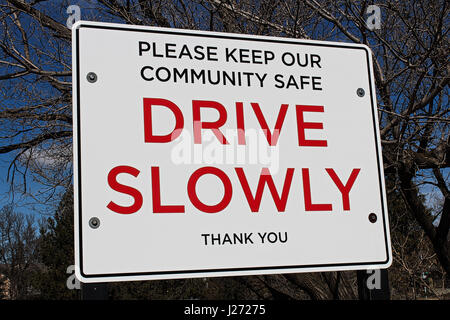 Drive slowly sign in a community area. - Stock Photo