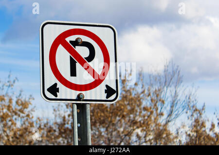 No parking left or right of the sign. - Stock Photo