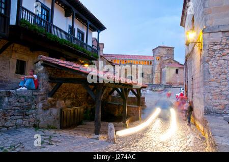 Street and collegiate church, night view. Santillana del Mar, Cantabria, Spain. - Stock Photo