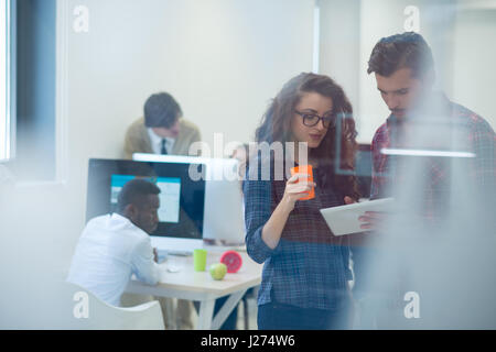 young startup business people, couple working on tablet computer - Stock Photo